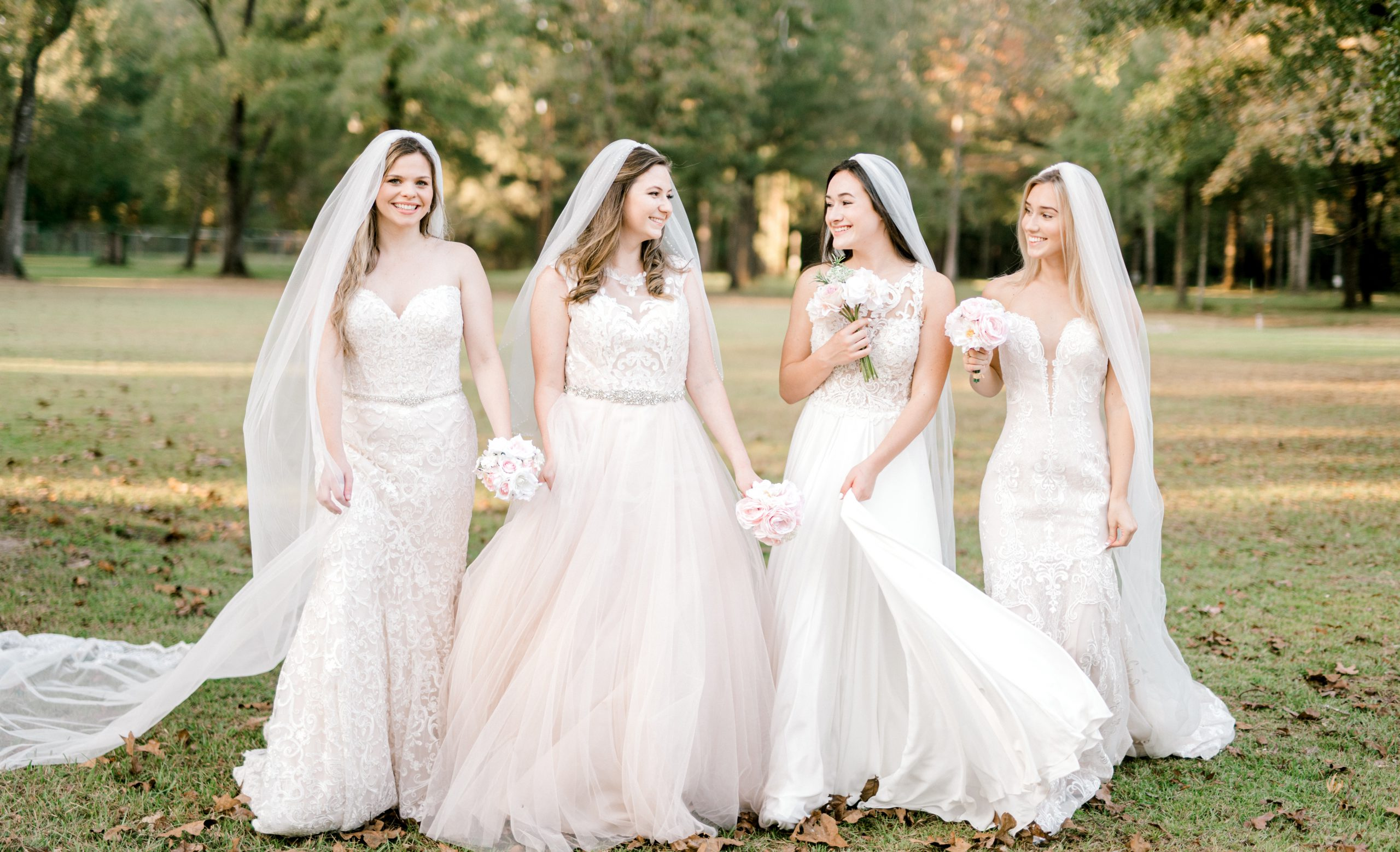 Brides modeling their gowns